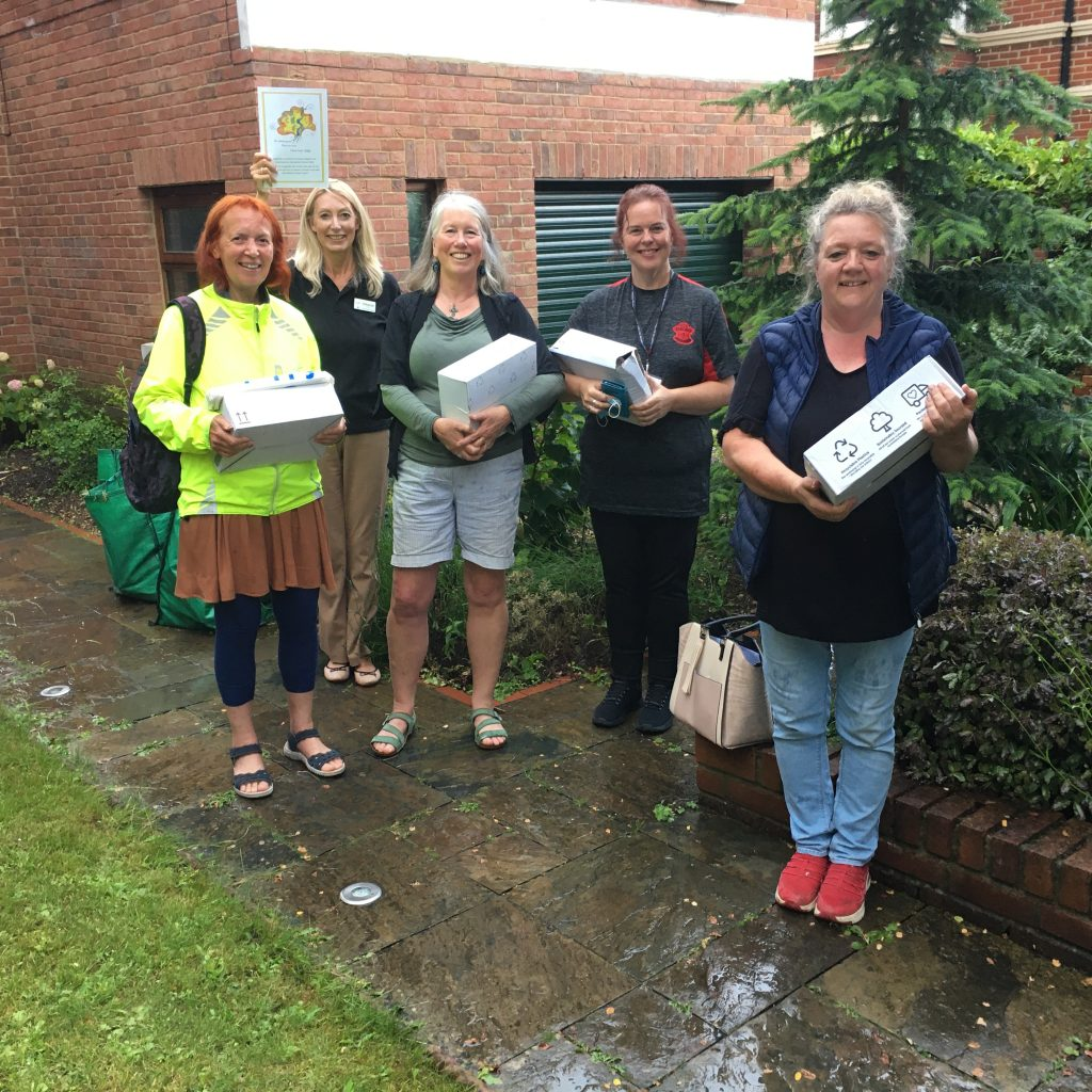 The dementia festival committee volunteers start delivering the dementia magazine they have produced